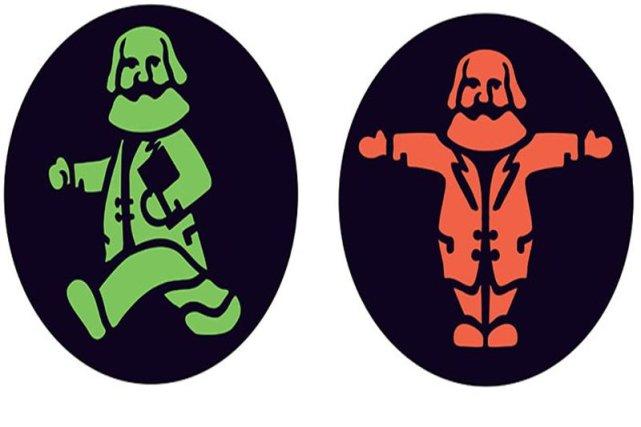 Zielone światło symbolizuje idący Marks, z książką i rozwianym płaszczem. Czerwone - Marks z wyciągniętymi na boki rękami